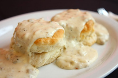 Buttermilk biscuits smothered with SAUSAGE gravy is a forever Southern staple!